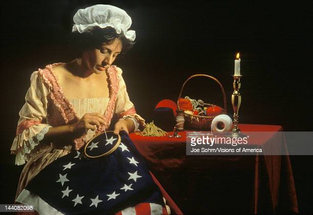 Living history reenactment of Betsy Ross making of first American flag Philadelphia Pennsylvania