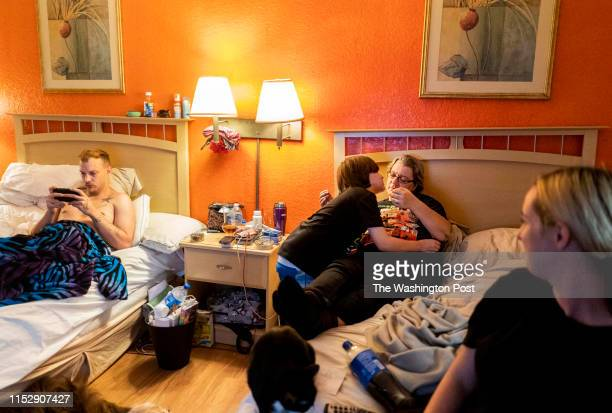 Living in an extended stay budget hotel because they cannot afford or find affordable housing Brian Mallow kisses his grandmother Shannon Berryhill...