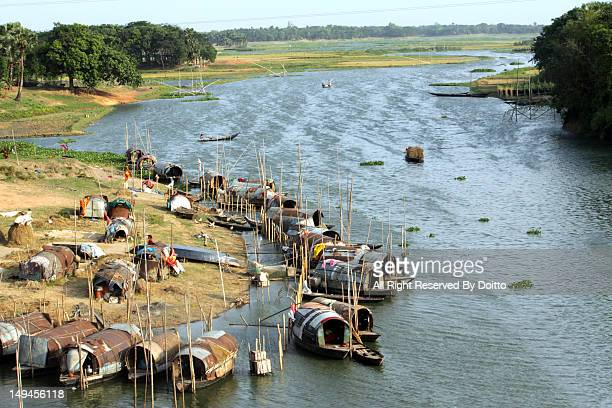 living in boat of typical village - bangladesh village stock photos and pictures