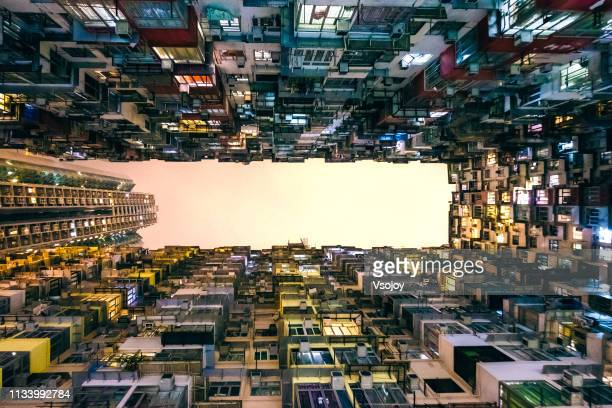 living in the tiny boxes, hong kong - vsojoy stock pictures, royalty-free photos & images