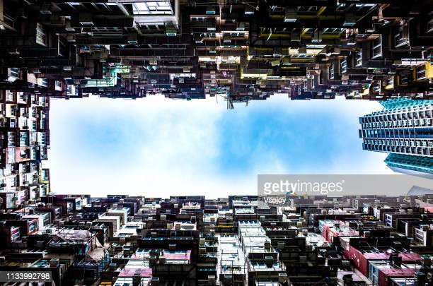living in the tiny boxes ii, hong kong - vsojoy stock pictures, royalty-free photos & images