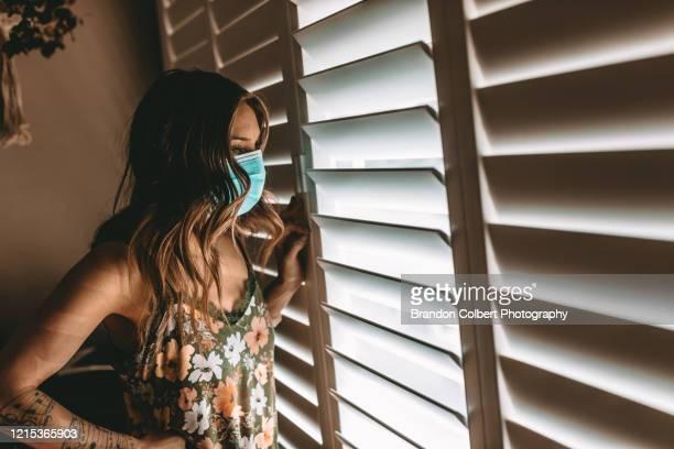 living life at home during covid-19 - munskydd ensam bildbanksfoton och bilder