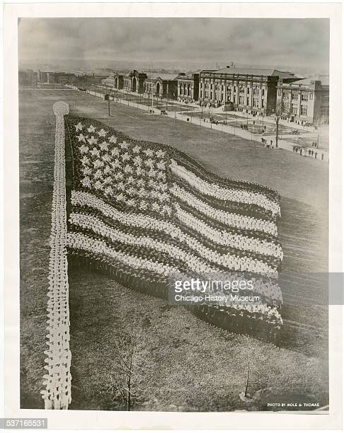 Living photograph of an American flag comprised of 10000 recruits at the Great Lakes Naval Training Station Illinois June 11 1917 Width of left side...