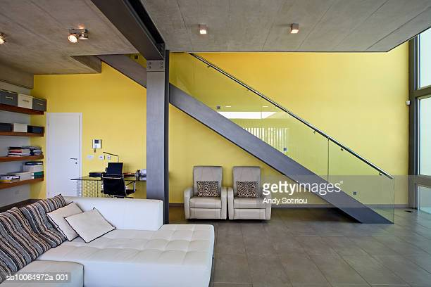 Living room and staircase in contemporary house