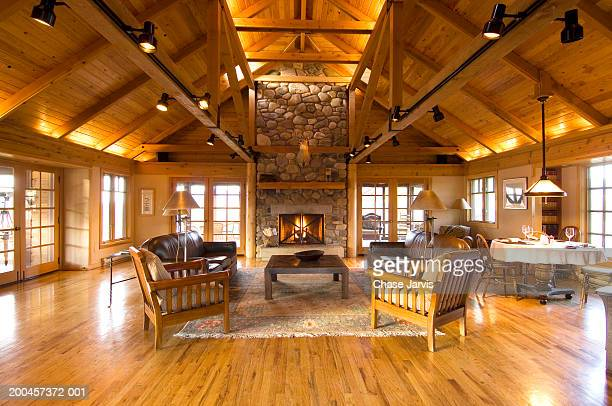 Living room and stone fireplace in cabin