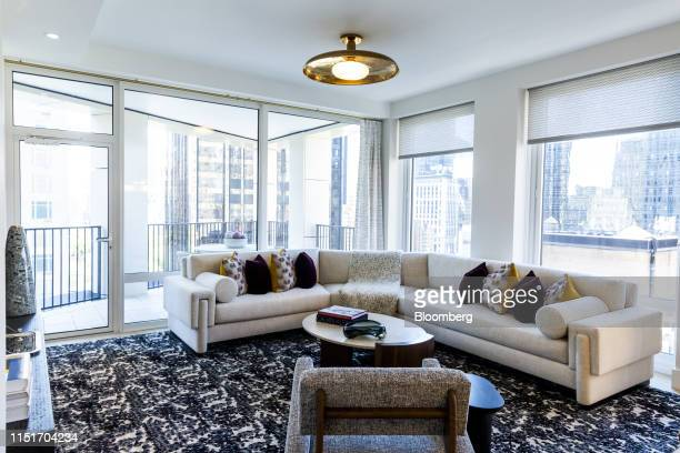 A living room area is seen staged at the AvalonBay Communities Inc Park Loggia condominium at 15 West 61 Street in New York US on Wednesday May 15...