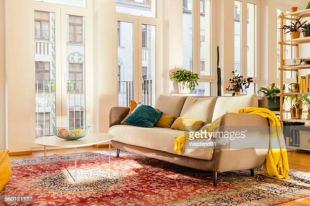 living room area with persian rug - persian rug stock photos and pictures
