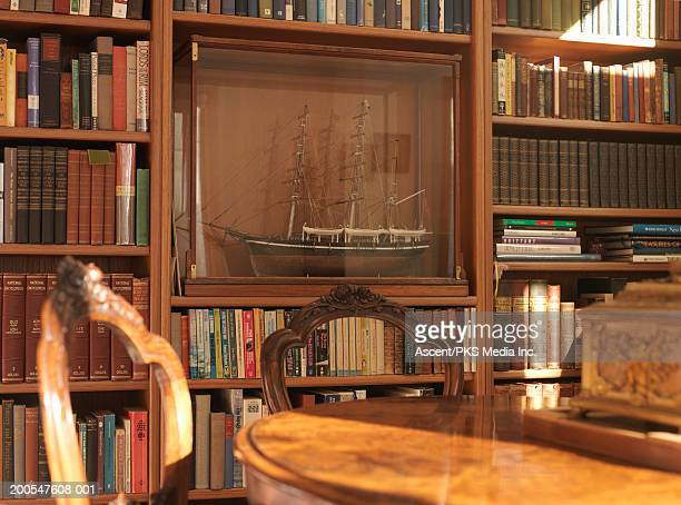 living room chairs and table, bookshelf in background - ship in a bottle stock pictures, royalty-free photos & images