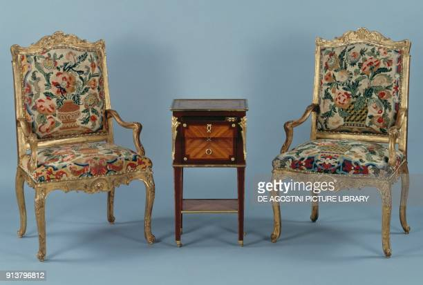 Living room furniture including two armchairs in Regency style and a coffee table in Louis XVI style. France, 17th-18th century.