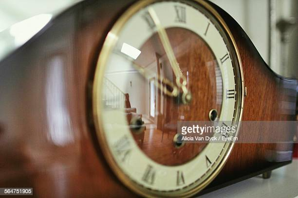 Living Room Furniture Reflection On Clock Glass