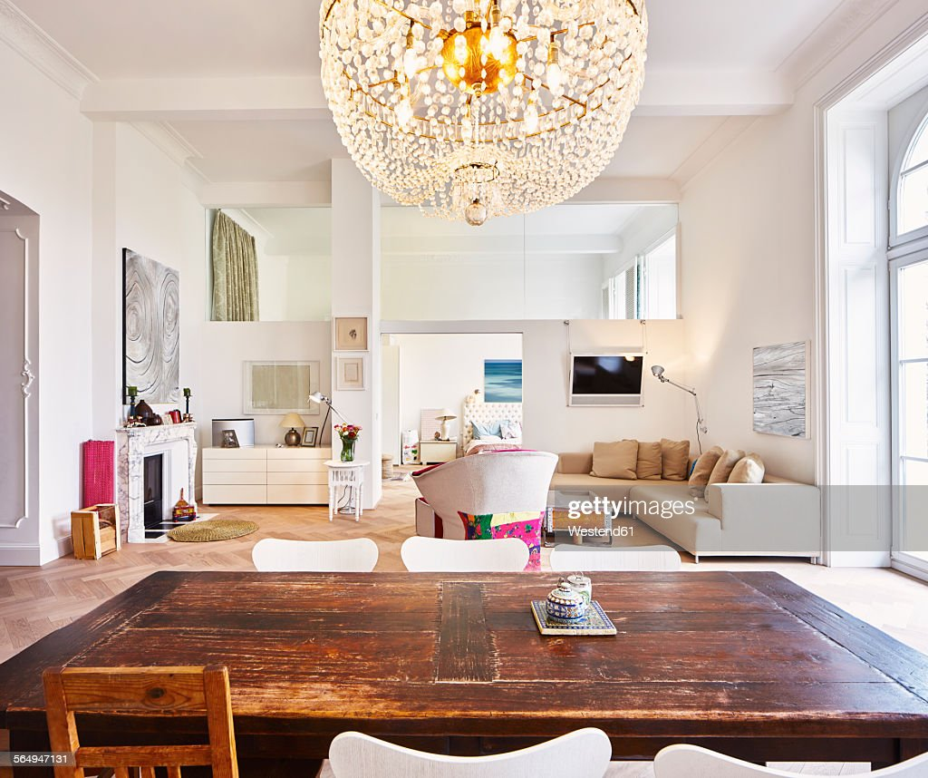 Living Room With Dining Table: Living Room In A Refurbished Old Building With Dining