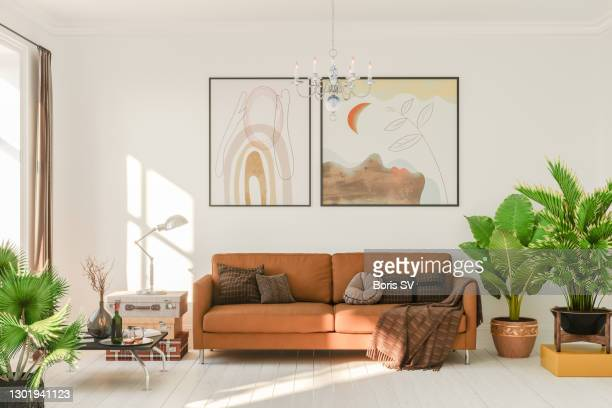 living room in boho style - living room stock pictures, royalty-free photos & images