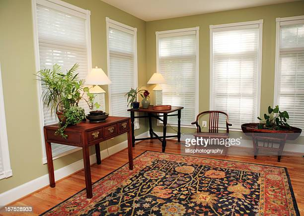 living room in model home - persian rug stock photos and pictures