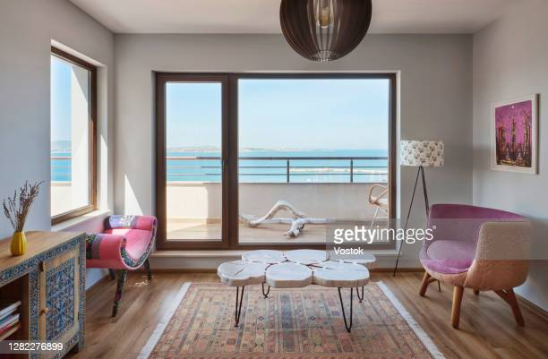 living room in the holiday apartment - seascape stock pictures, royalty-free photos & images
