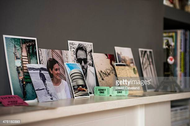living room mantelpiece with travel souvenirs and photographs - postcard stock pictures, royalty-free photos & images