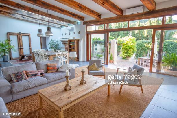 living room view on to courtyard of spanish farmhouse, barcelona - patio doors stock pictures, royalty-free photos & images
