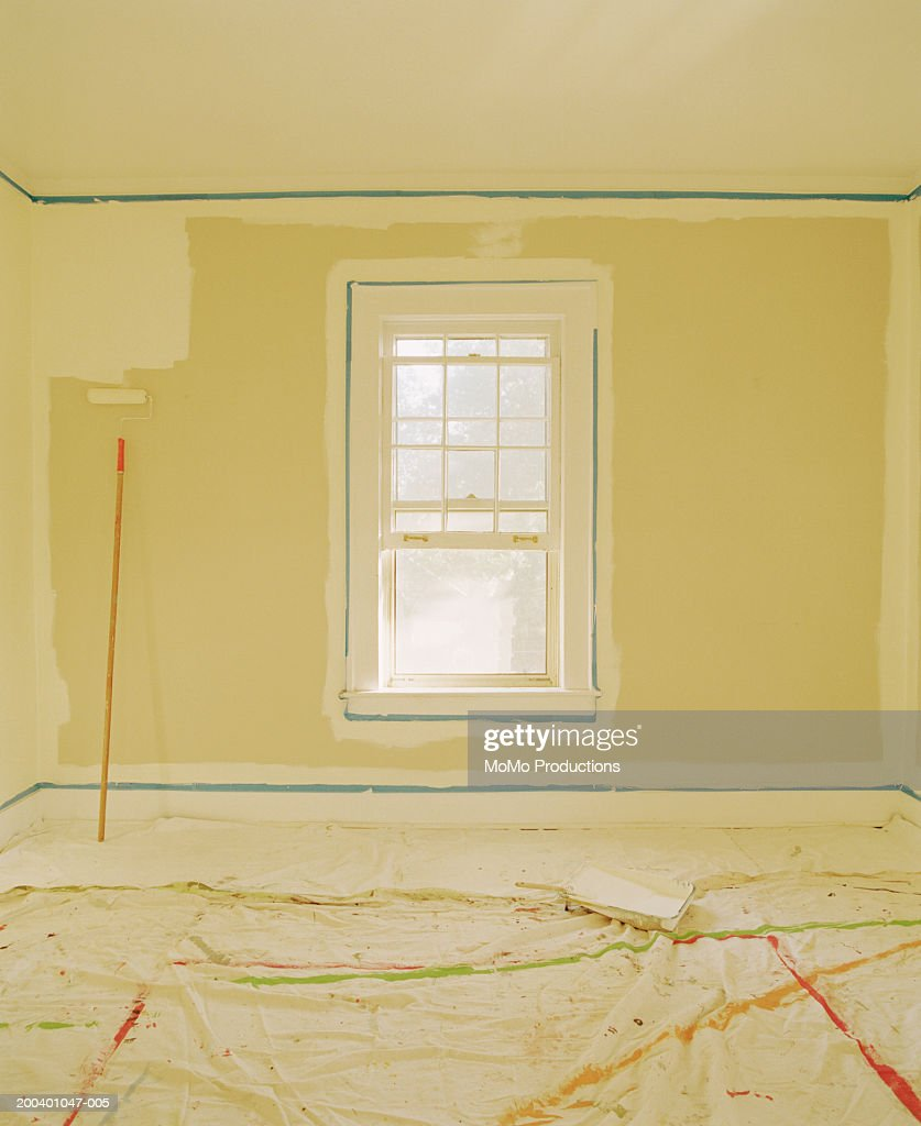 Living Room Wall Being Painted Stock Photo | Getty Images