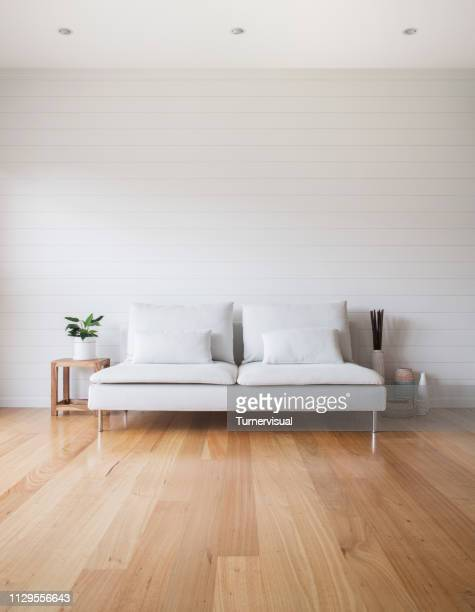 living room white couch timber floor - ceiling stock pictures, royalty-free photos & images