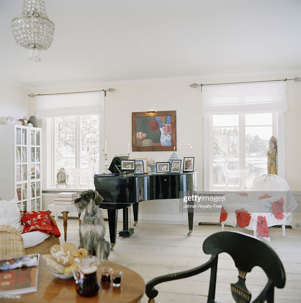 A Living Room Wit A Piano In The Middle Stock Photo | Getty Images