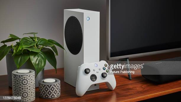 Living room with a Microsoft Xbox Series S home video game console alongside a television and soundbar, taken on October 27, 2020.
