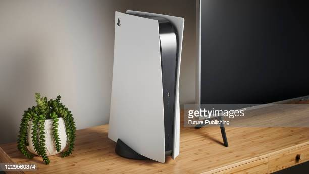 Living room with a Sony PlayStation 5 home video game console alongside a television, taken on Novemebr 3, 2020.