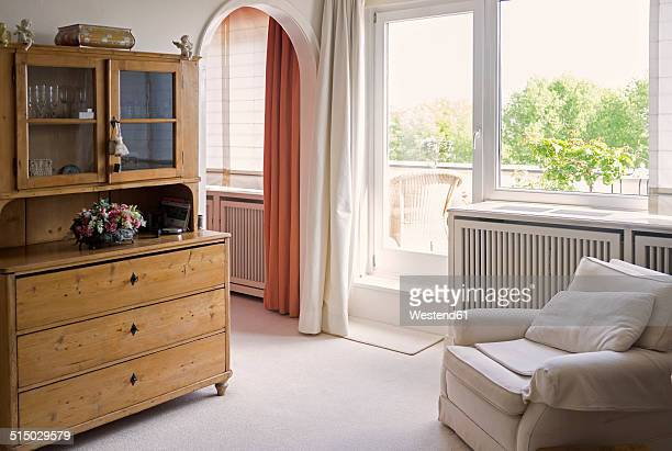 Living room with armchair and old cupboard
