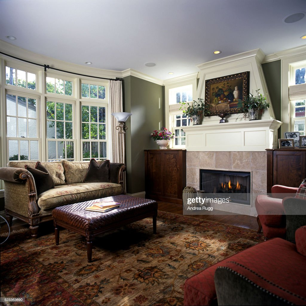 Living Room With Bay Window And A Stone Fireplace High-Res ...