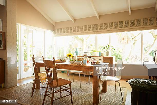 living room with breakfast table - dining room stock pictures, royalty-free photos & images