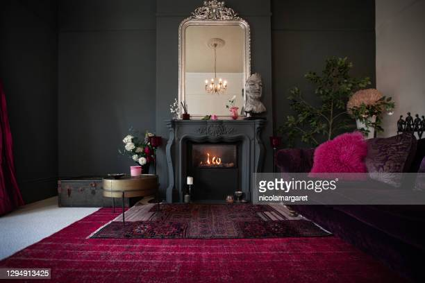 living room with dark walls and authentic fireplace - maroon stock pictures, royalty-free photos & images
