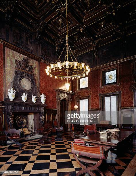 Living room with fireplace and large central chandelier Bagatti Valsecchi museum Milan Lombardy Italy