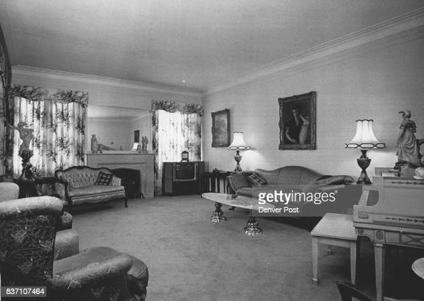 Living room with furniture installed when the home was built in 1936 features a small Gainsborough portrait and a Morland portrait just two of a fine...