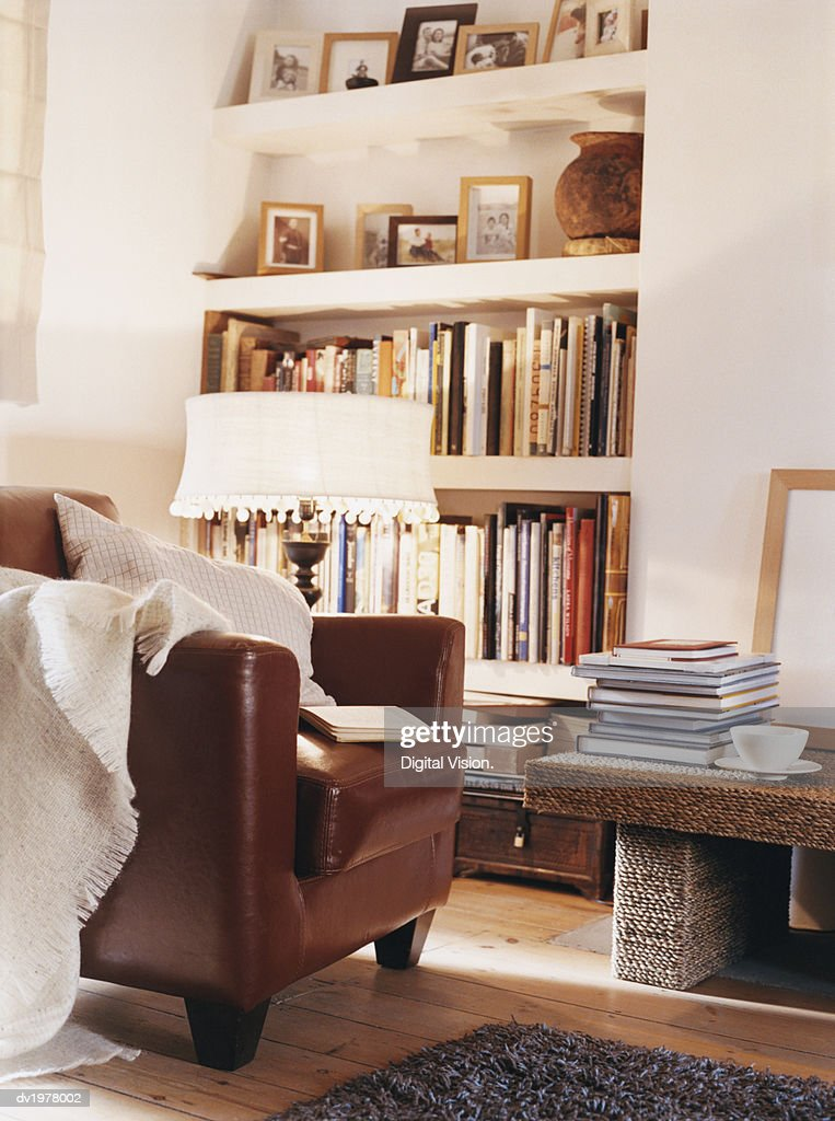 Living Room With Leather Armchair and Book Shelves : Stock Photo
