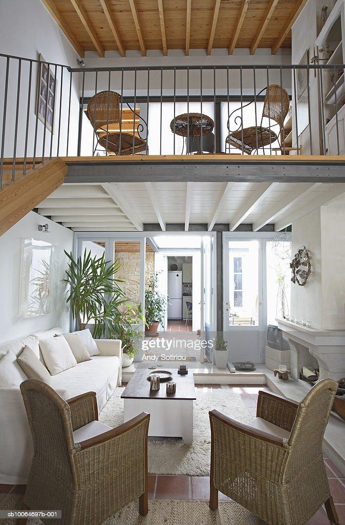 Living room with mezzanine : Stock Photo