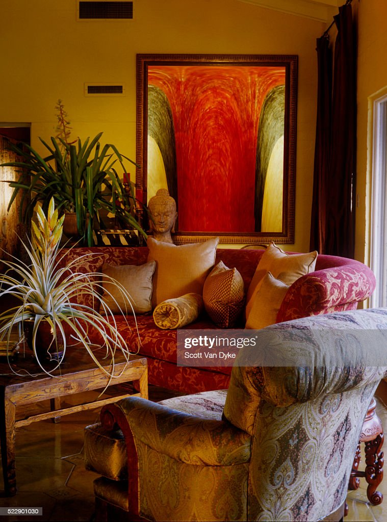 Living Room With Overstuffed Sofa And Chair Decorated Stone Buddha Head Stock Photo