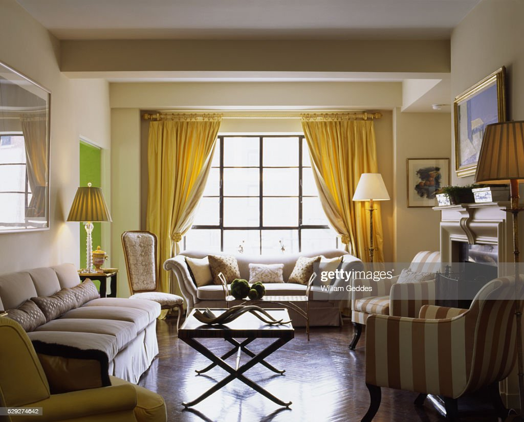 living room with two couches. Living room with two couches coffee tables and gold curtains  Stock Photo Room With Two Couches Coffee Tables And Gold Curtains