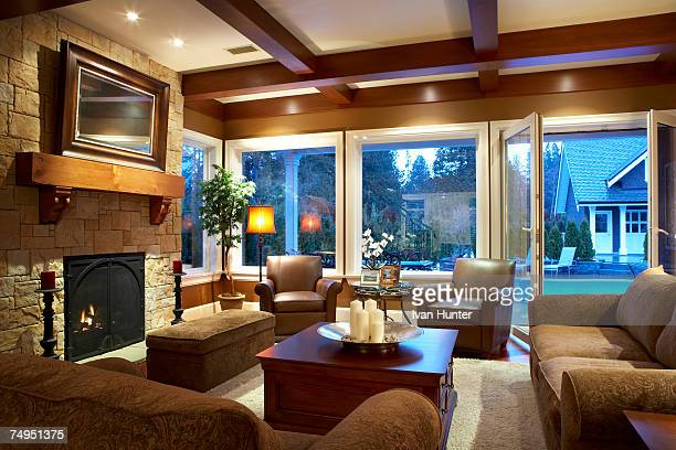 Living room with wood beams on ceiling and fireplace