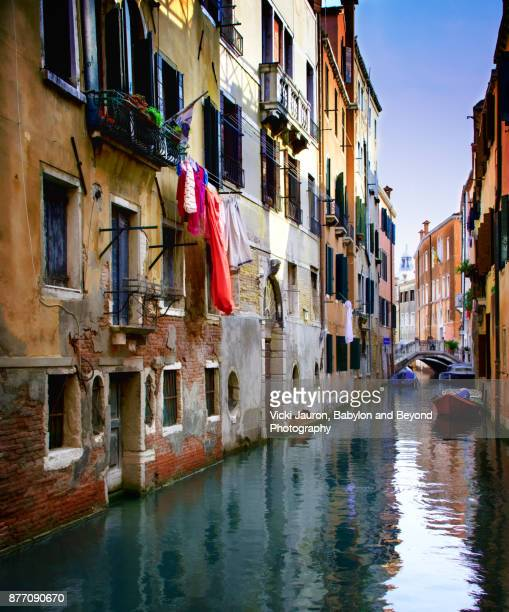 Living Scene Along Canal in Venice, Italy