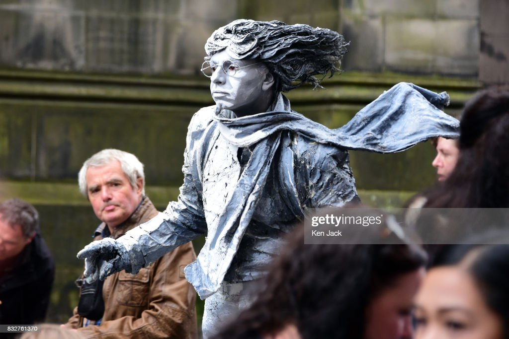 A 'living statue' street performer on the Royal Mile during the Edinburgh Festival Fringe, on August 16, 2017 in Edinburgh, Scotland. The Fringe is celebrating its 70th year, and this year hosts over three thousand shows and more than 50,000 performances.