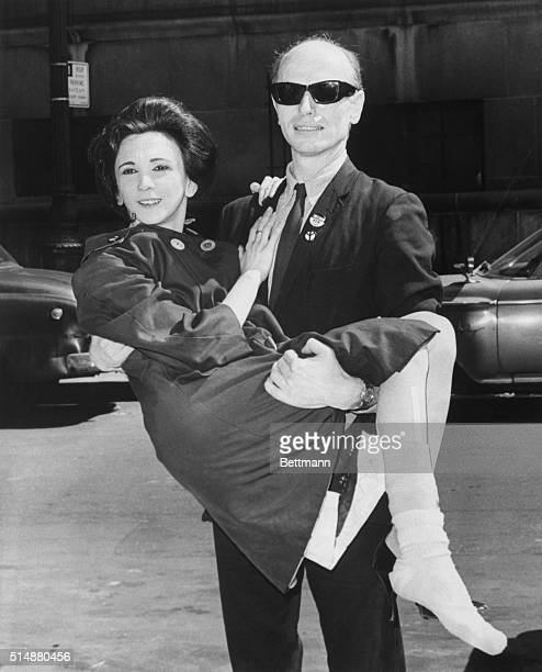 Living Theater owner Julian Beck carries his wife, actress Judith Malina, into Federal Court to face charges that they violated tax laws in the...