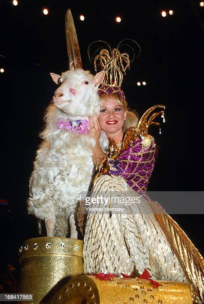 """Living """"unicorn"""" is photographed with performer Heather Narris at a performance of the Ringling Brothers Barnum and Bailey Circus April 11, 1985 in..."""