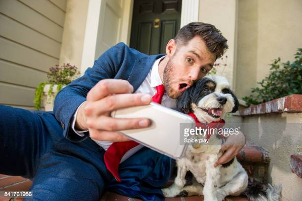 Living with Pets - Businessman Taking Selfie with his Dog