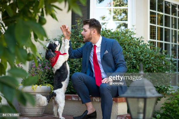 Living with Pets - Businessman Training His Dog