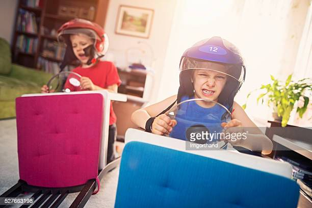 Livingroom race - little boys pretending to ride race cars