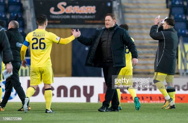 Livingston manager David Hopkin with Craig Halkett at full time