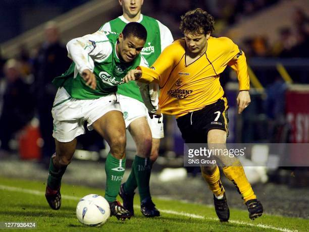 Hibs stopper Matthias Doumbe tries to exchange jerseys with David Fernandez before the end of the match