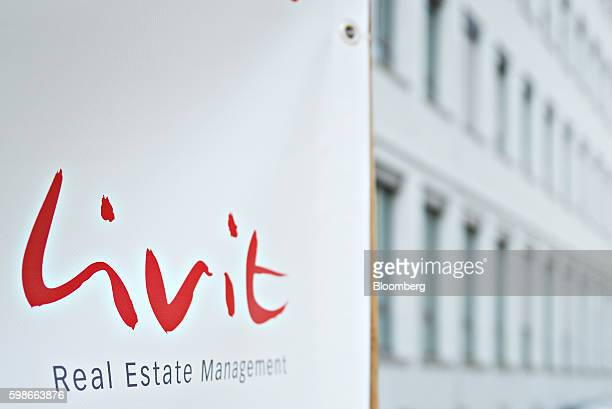 A Livit AG real estate management sign stands outside a block of managed residential apartments in Zurich Switzerland on Thursday Sept 1 2016 Risks...