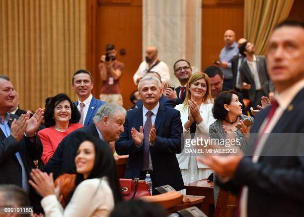 Liviu Dragnea the leader of the ruling Social Democrat party applauds after the vote on a motion of censure against Romanian Prime Minister Sorin...