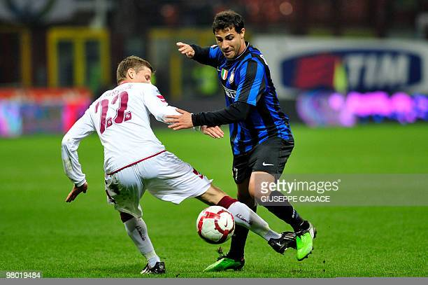 Livorno defender Alessandro Grandoni fights for the ball with Inter Milan's Portuguese midfielder Ricardo Quaresma during their Serie A football...