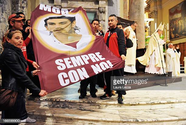 Livorno fans show a banner during a mass in memory of Piermario Morosini in the Cathedral on April 14, 2013 in Livorno, Italy. Morosini died, aged...