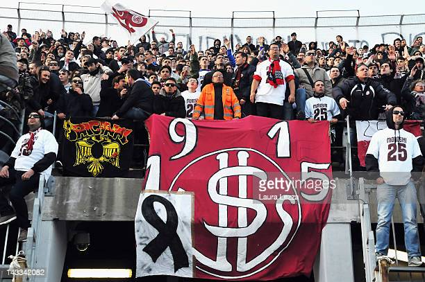 Livorno fans wear jerseys bearing the number 25 and show a banner draped in mourning as they pay tribute to Piermario Morosini during the Serie B...